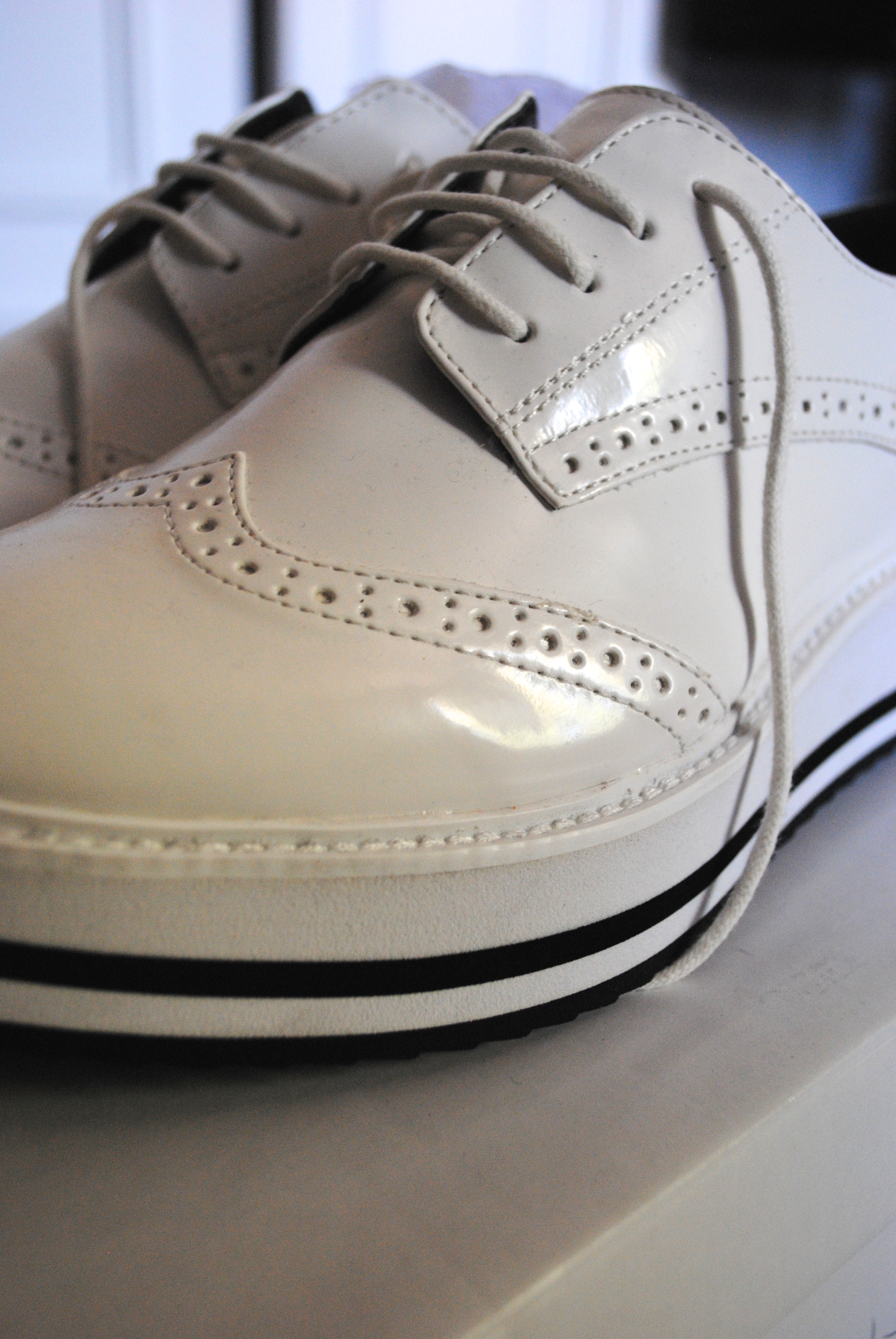 white patent brogues