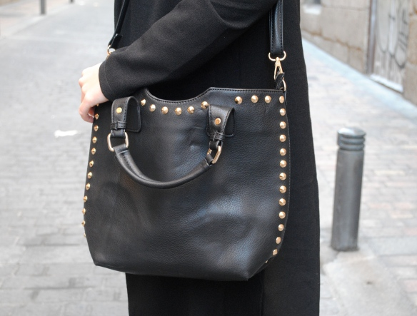 gold studded black bag