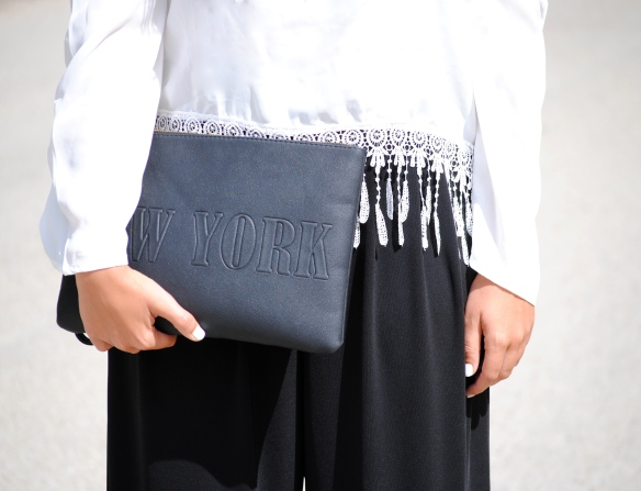 black new york clutch