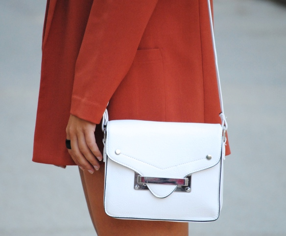 white buckle bag